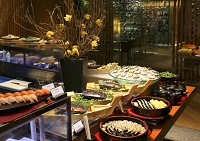 1. A variety of seafood and sushi featured at the buffet table